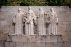 Reformation wall in Geneva. Stone statues of Guillaume Farel, Jean Calvin, Théodore de Bèze and John Knox in Bastions Park Stock Image
