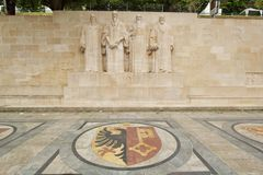 Reformation wall, Geneva, Switzerland. Sculptures of the four great figures of the geneva protestant movement : Guillaume Farel (1489 - 1565), Jean Calvin (1509 Stock Photo