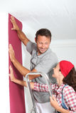 Reforming new home. Couple choosing color of new paperwall Royalty Free Stock Photography