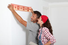 Reforming new home. Couple choosing color of new paperwall Royalty Free Stock Photo