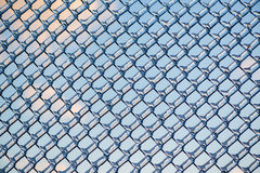 Refracted Clouds and Blue Sky Through Ice on Fence Royalty Free Stock Photography