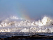 Refraction. A rainbow over the ocean waves Stock Image