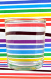 Refraction of the lightin a glass. Refraction of the light of a colored striped backgound Stock Photography