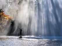 Refractions Of Sunlight Through A Fountain Stock Photography