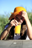 Refresh holiday. Woman refreshing with an orange juice during her holiday Royalty Free Stock Photography
