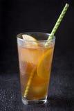 Refresh Ice tea with lemon. Black stone background Royalty Free Stock Images