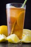Refresh Ice tea with lemon. Black stone background Stock Photo