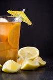 Refresh Ice tea with lemon. Black stone background Royalty Free Stock Image