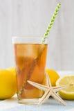 Refresh Ice tea with lemon on summer towel Stock Photography