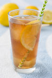 Refresh Ice tea with lemon on summer towel Stock Photos