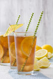 Refresh Ice tea with lemon on summer towel Royalty Free Stock Images