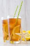 Refresh Ice tea with lemon on white wood Stock Photos