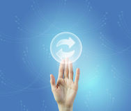 Refresh interface icon. Male hand touching reload icon of media screen Stock Photos
