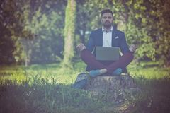 Refresh your mind. Business man working yoga royalty free stock photos