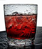 Refresh Yourself. A cold drink of cran-strawberry juice on ice Stock Photography
