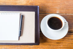 Refreshed coffee break on work table Royalty Free Stock Photos