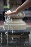 Refreshed hand at a water fountain Royalty Free Stock Photo
