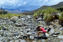 Refreshed. Quenching thirst on mountain hiking Stock Photography