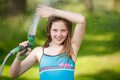 Refreshing. Girl refreshing herself outdoor with water royalty free stock photos