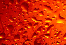Refreshing beer. Background with light glowing through cold water condensation Stock Images