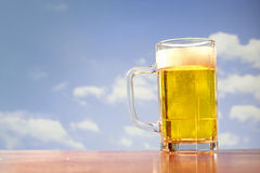 Refreshing beer mug on sky background Royalty Free Stock Photography