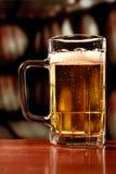 Refreshing beer mug on vintage background Stock Photos