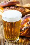 Refreshing beer ready to drink and fresh bavarian pretzels Stock Photo