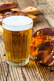 Refreshing beer ready to drink and fresh bavarian pretzels Stock Image