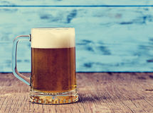 Refreshing beer served in a glass mug Stock Photos