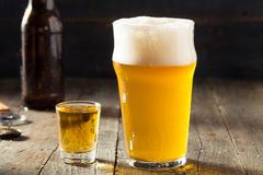 Refreshing Beer and Whiskey Shot Boilermaker. Cocktail Drink Stock Photo