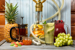 Refreshing beverages and hookah Stock Images