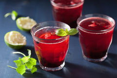 Refreshing blueberry drink with lime and mint Stock Photography