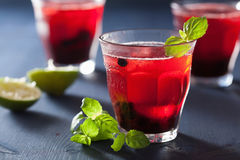 Refreshing blueberry drink with lime and mint Stock Photo