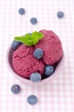 Refreshing blueberry sorbet and fresh blueberries. Refreshing blueberry sorbet in a bowl and fresh blueberries, top view royalty free stock photos