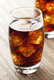 Refreshing Brown Soda with Ice. On a background Royalty Free Stock Images
