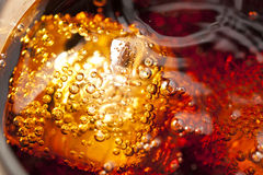 Refreshing Brown Soda with Ice. On a background Royalty Free Stock Photography
