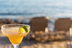 Refreshing Classic Margarita Cocktail With Lime And Salt By The Beach At Sunset On Blurred Background royalty free stock images