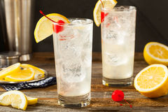 Refreshing Classic Tom Collins Cocktail. With a Cherry and Lemon Slice Royalty Free Stock Photo