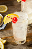 Refreshing Classic Tom Collins Cocktail. With a Cherry and Lemon Slice Stock Photo