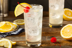 Refreshing Classic Tom Collins Cocktail. With a Cherry and Lemon Slice Stock Image