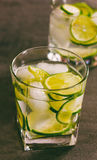 A refreshing cocktail with green lemon and ice close-up Stock Photo