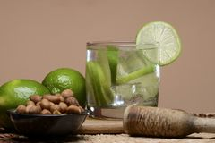 Refreshing cocktail with green lemon and ice. royalty free stock photo