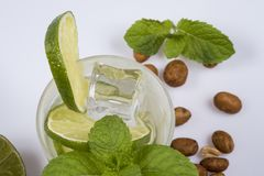 Refreshing cocktail with green lemon and ice. stock photography