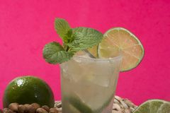 Refreshing cocktail with green lemon and ice. stock photos