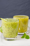Refreshing cocktail of kiwi and mint Stock Photos