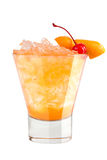 Refreshing cocktail with orange peel and maraschino cherry decoration. On white background Royalty Free Stock Photos