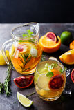 Refreshing cocktail with red blood orange,. Ice and mint on a dark stone background royalty free stock image