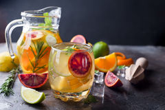Refreshing cocktail with red blood orange,. Ice and mint on a dark stone background royalty free stock photo
