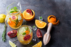 Refreshing cocktail with red blood orange,. Ice and mint on a dark stone background, copy space flat lay royalty free stock photos