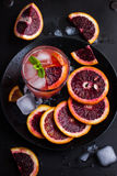 Refreshing cocktail with red blood orange, ice and mint. Top view royalty free stock image
